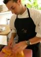 Chef Voisin cutting papaya