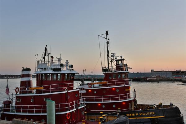 tugs and sunset