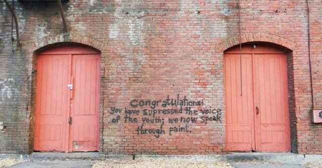 suppress-gritty-brick-wall